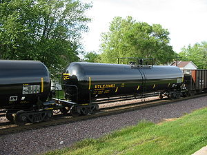 Union Tank Car Company - A UTLX tank car passes westbound through Rochelle Railroad Park in Rochelle, Illinois on May 29, 2005.