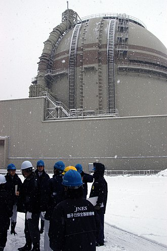 Ōi Nuclear Power Plant - Japanese officials and IAEA team members discuss safety measures outside Unit 3 of Japan's Ōi Nuclear Power Plant in January 2012