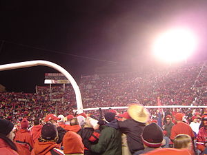 Utah Utes football - Utah fans carry the goalpost after the Utes completed a perfect regular season.