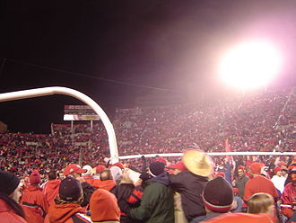 2004 Utah Utes football team - Utah Utes fans rush the field and carry the goalpost after defeating rival BYU, completing a perfect regular season, and becoming the first BCS Buster by clinching a spot in the 2005 Fiesta Bowl (hence the sombrero).