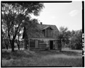VIEW OF EAST AND SOUTH SIDES. VIEW TO NORTHWEST - Henry Williams House, Nicodemus, Graham County, KS HABS KANS,33-NICO,1-T-6.tif
