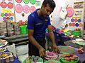 Vendor demonstrating making of Rangoli using moulds, Kundanahalli, Bangalore.jpg