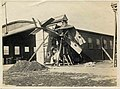 View of an British RFC biplane, with plane number B-2762, crashed into the side of an airplane hangar in France during World War I (circa 1918) (Photograph taken or collected by Henry L. (29248784963).jpg
