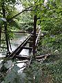 Ville-sur-Saulx (Meuse) papeterie du château (04), pont en fonte (rails) sur la Saulx.jpg