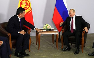 Jeenbekov with Russian President Vladimir Putin during a meeting in Sochi, Russia. Vladimir Putin and Sooronbay Jeenbekov (2018-05-14) 02.jpg