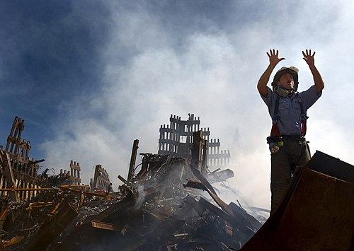 A New York City fireman calls for 10 more rescue workers to make their way into the rubble of the World Trade Center following the September 11 attacks.
