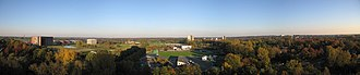 Wageningen University and Research Centre - Panorama of the campus of Wageningen University with the Forum, Gaia, Lumen and Atlas buildings on the left, the sport center in the foreground, and the northeastern part of Wageningen on the right.