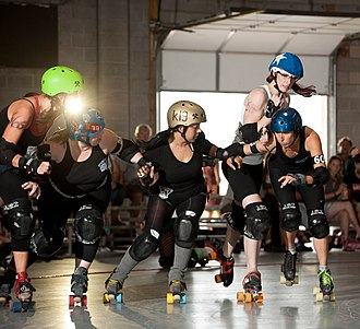 "Roller derby - From left to right, ""The Alexorcist,"" ""Margie Ram,"" ""Chiquita WhamBamYa,"" ""Bunz Bunny,"" and ""Lady Shatterly"" skate in a roller derby scrimmage in Utah."