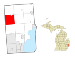Location within Macomb County (red) and an administered portion of the Romeo village (pink)
