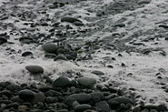 Wave Retreating from Pebbles