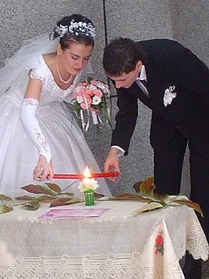Unity candle - Couple lighting a unity candle