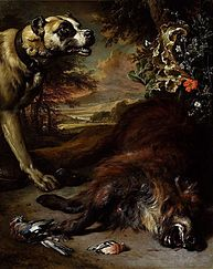 A dog over a dead boar.