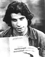 John Travolta holding up a journal
