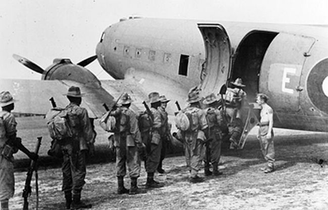 Troops of the Nigeria Regiment, 3rd West African Brigade (Thunder), board an RAF Dakota - Chindits