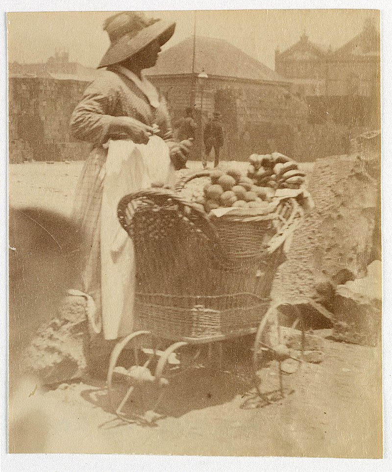 Woman selling fruit from small barrow Sydney, ca. 1885-1890 - photographed by Arthur K. Syer (5775144516).jpg
