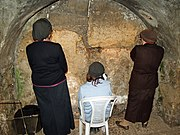 Women praying in the Western Wall tunnel at the closest physical point to the Holy of Holies that women can be.