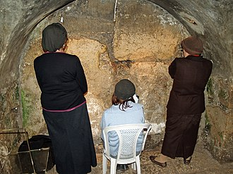 Holy of Holies - Women praying in the tunnel at the closest physical point not under Islamic Waqf jurisdiction to the Holy of Holies