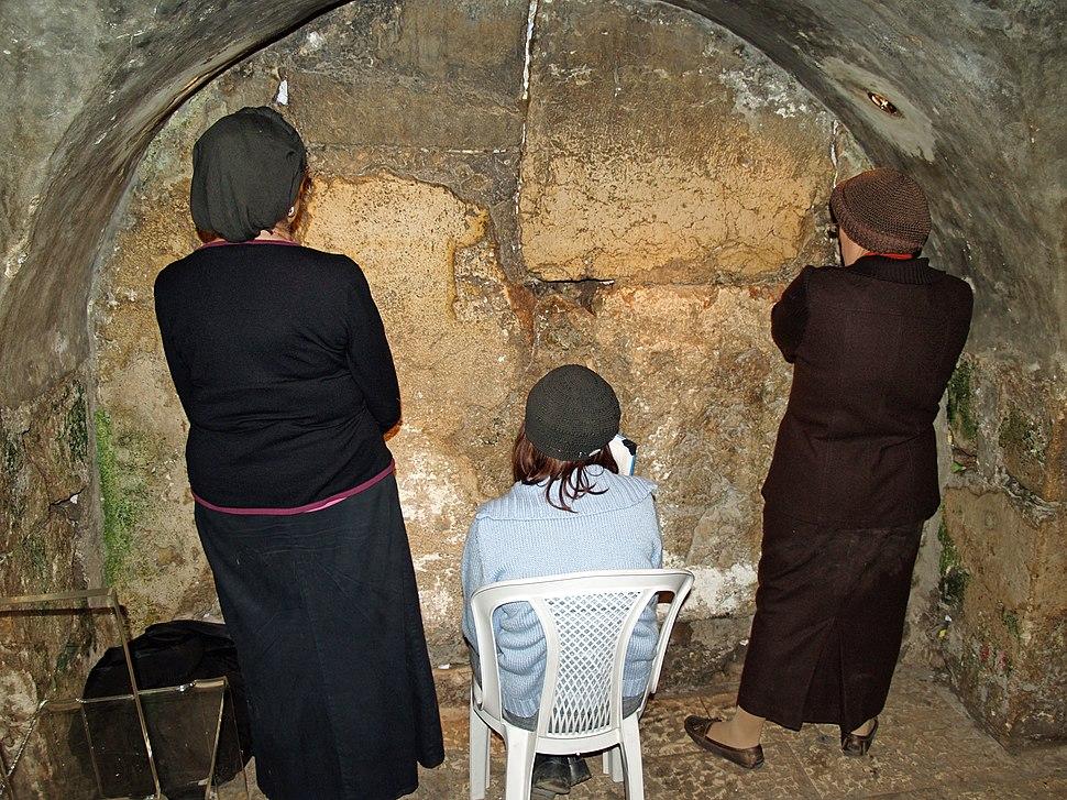 Women praying in the Western Wall tunnels by David Shankbone