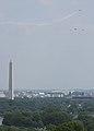 World War II era planes fly over Washington, D.C. seen from Arlington National Cemetery (16811426043).jpg