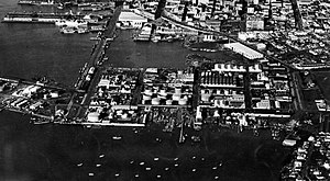 "Wynyard Quarter - Seen eastwards from an airplane in the 1950s, when it was known as ""Western Reclamation"" or ""Tank Farm""."