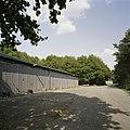 Zicht op een gedeelte van een gevel van een opslagloods - Landhorst - 20389938 - RCE.jpg