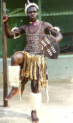 Zulu people - Zulu man performing traditional warrior dance