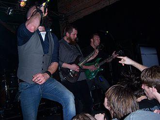 Adam Dutkiewicz - Adam Dutkiewicz (far right) performing in Times of Grace.
