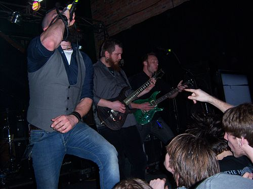 "Joel Stroetzel (in middle) performing in Times of Grace along with Jesse Leach and Adam Dutkiewicz. ""Times Of Grace Live!.jpg"