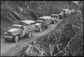 """U.S.-built Army trucks wind along the side of the mountain over the Ledo supply road now open from India into Burma..."" - NARA - 535540.tif"