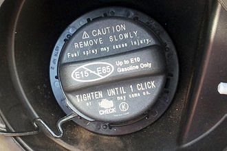 Common ethanol fuel mixtures - 2012 Toyota Camry Hybrid fuel filler cap showing warning  regarding the maximum ethanol blend allowed by the carmaker, up to E10 gasoline. The warning label indicates that ethanol blends between E15 to E85 shall not be used in this vehicle.
