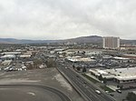 2015-10-27 15 36 54 View west along Mill Street towards downtown Reno, Nevada from an airplane landing at Reno-Tahoe International Airport.jpg