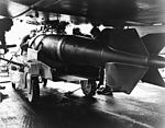 A-1 Skyraider of VA-95 is armed on USS Ranger (CVA-65) in March 1965.jpg