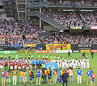AC Milan and Real Madrid players line up at Yankee Stadium.jpg