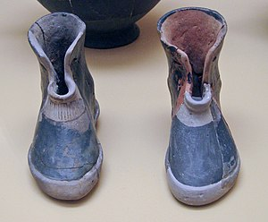 Greek Dark Ages - Ancient Greek pair of terracotta boots. Early geometric period cremation burial of a woman, 900 BC. Ancient Agora Museum in Athens.