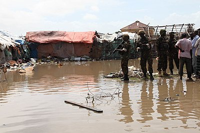 AMISOM peacekeepers seen assessing sitaution of a submerged IDP camp in Kismayu (1).jpg (14335624736).jpg