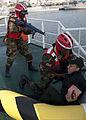 A Liberian coast guardsman, center, assists a Moroccan sailor portraying a casualty during maritime interdiction training aboard the Spanish Civil Guard patrol ship Rio Segura March 9, 2014, in Dakar, Senegal 140309-N-QY759-126.jpg