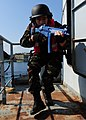 A Moroccan sailor practices boarding tactics aboard the training ship HS Aris (A 74) at the NATO Maritime Interdiction Operational Training Center in Souda Bay, Greece, May 10, 2012 during Phoenix Express 2012 120510-N-QD416-046.jpg