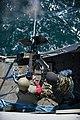 A Sailor fires a .50-caliber machine gun. (6852044931).jpg