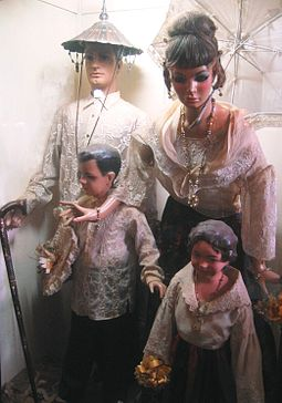 Typical costume of a family belonging to the Principalia of the late 19th century Philippines. Exhibit in the Villa Escudero Museum, San Pablo, Laguna. A family belonging to the Principalia.JPG