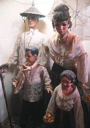 Tagalog people - Costume typical of a family belonging to the Principalía wearing Barong Tagalog and baro't saya.