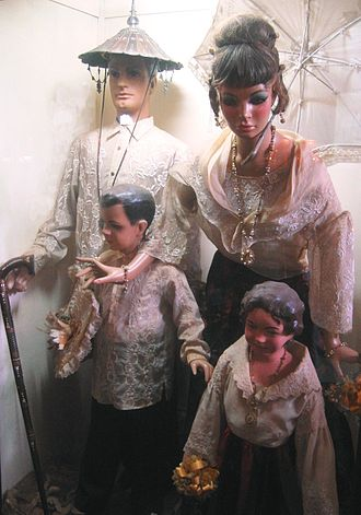 Filipinos - Typical costume of a Principalía family of the late 19th century. Exhibit in the Villa Escudero Museum, San Pablo, Laguna, Philippines.