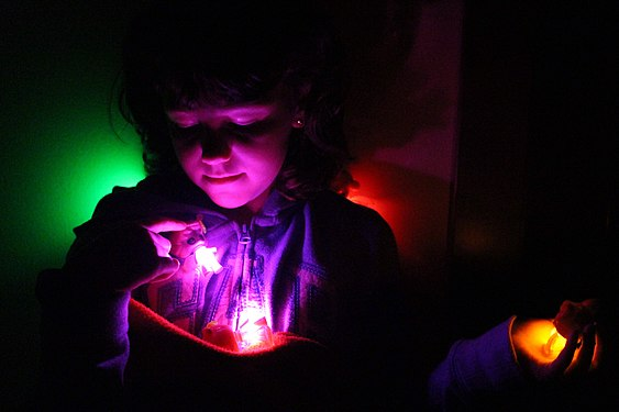 A little girl playing with the lights.jpg
