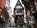 A very old traditional house (15th century) that conflicts with stability at Bernkastel-Kues - panoramio.jpg