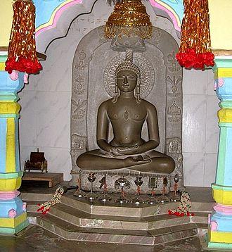 Ashtamangala - Adinath image with Ashtamangala placed in front of it, according to Digambara tradition