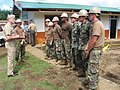 Adm. Walsh speaks with Seabees from Navy Mobile Construction Battalion (5893399699).jpg