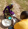African People at Work-Fulani Woman Selling Fresh Milk.jpg