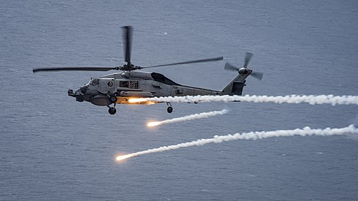 An MH-60R Sea Hawk fires chaff flares during a training exercise. (34287318195)