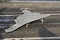 An X-47B conducts a touch and go landing. (8782295675).jpg