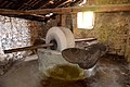 Ancient oil press in olive oil production workshop in Trsteno 04.jpg