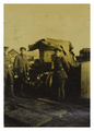 Armoured cars on the barge 1916.png